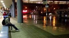 People waiting for taking bus at Metrotown bus station on raining day. Stock Footage