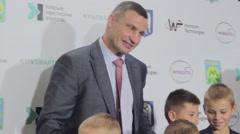 Vitali Klitschko is photographed with children. Stock Footage