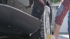 Car Care - Washing a car by hand - sliding camera Stock Footage