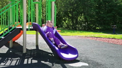 Cute toddler at playground in sunny day Stock Footage