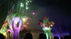 Enormous floating figures in front of a firework Stock Footage