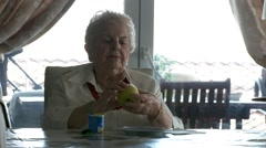 Old woman eating healthy - stock footage