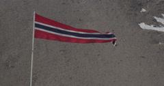 Norwegian Flag flies above Ny-Ålesund - Close Stock Footage