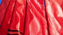 Decorative red flags waving in wind Stock Footage