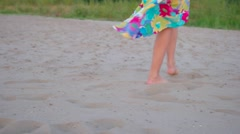 Outdoor summer image of young beautiful woman legs walking on the beach in Stock Footage
