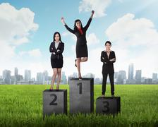 Business person standing on the podium Stock Photos