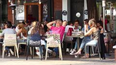 City an overview of the crowded cafe in a European capital Stock Footage