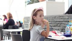 City beautiful little girl with a tiara with asterisks are in the restaurant Stock Footage