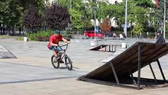 City Cyclists on a special platform makes Extreme tricks Stock Footage