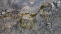 Full frame of close up of lively running and rippling water - stock footage
