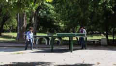 City Park kids and adults to play table tennis at the weekend.mp4 Stock Footage