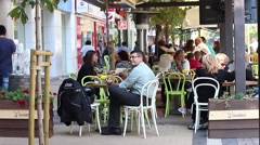 City people relax in a cafe during the lunch break Stock Footage