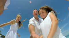 Selfie portrait of happy young Caucasian family on beach - stock footage