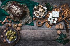 Stock Photo of Rustic style olives, nuts mushrooms  and bread  with seeds