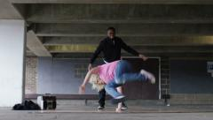 4K Female breakdancer dancing as her friend watches on, shot on RED EPIC DRAGON - stock footage