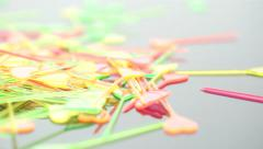 A pile of color heart-shaped party picks Stock Footage