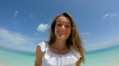 Selfie portrait of female Caucasian teenager with a starfish Stock Footage