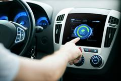 Male hand setting car eco system mode on screen Stock Photos