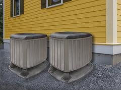 Two modern air conditioning heat pumps - stock photo
