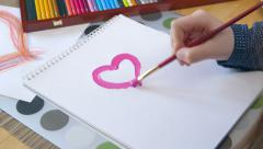 Girl Painting a Heart - stock footage