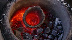 The hot crucible is in the furnace Stock Footage