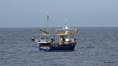 Fisher prepares his nets on the north sea Stock Footage