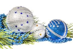 Christmas tree branch and blue with white glitter balls Stock Photos