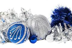 Christmas blue tinsel and blue with  silver glitter balls - stock photo
