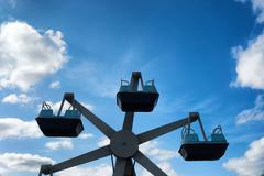Older children's carousel on the sky background - stock photo