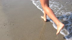 Walking on sand beach waves, footsteps in sand Stock Footage