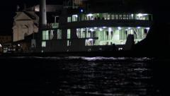 Bright Ferry on Dark Water Stock Footage