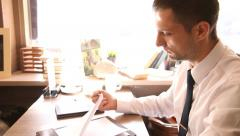 Serious businessman examining documents and signing Stock Footage