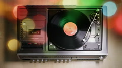 Vintage record player playing vinyl disc in disco light Stock Footage