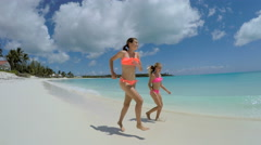 Young Caucasian female children in swimwear enjoying tropical vacation - stock footage