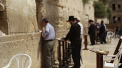Orthodox Jews pray at the Wailing Wall, Jerusalem, Israel - stock footage