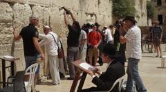 Bar Mitzva boy takes photos at the Wailing Wall, Jerusalem, Israel Stock Footage