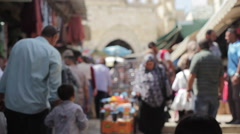 People shop in a busy middle east market, old Jerusalem, Israel Stock Footage
