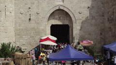 Damascus Gate main entrance to Jerusalem old city, merchants shoppers Stock Footage
