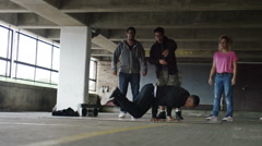 4K Male breakdancer performing as friends cheer him on,  shot on RED EPIC DRAGON - stock footage