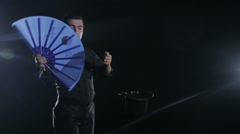 Beautiful magician's trick with a fan Stock Footage