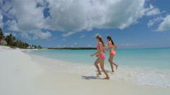 Caucasian young girls in swimwear having fun playing Stock Footage