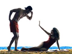 Couple on the beach Sexual Harassment Stock Photos