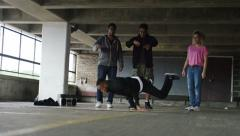 4K Breakdancer spins as friends watch, in slow motion, shot on RED EPIC DRAGON Stock Footage