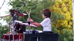 Little teen boy play drums at rock band during concert performance Stock Footage