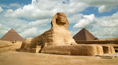 Stock Video Footage of Timelapse of the famous Sphinx with great pyramids in Giza valley, Cairo, Egypt