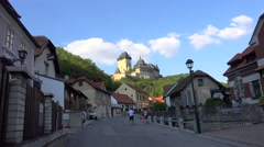 Tourists in the Karlstejn Town (Beroun District) below the Karlstejn castle Stock Footage