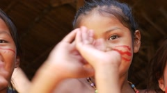 Cute native Brazilians having fun at an indigenous tribe in the Amazon Stock Footage