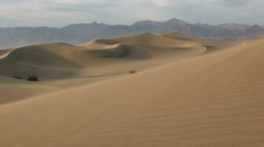 Wind blowing over desert sand dunes Stock Footage