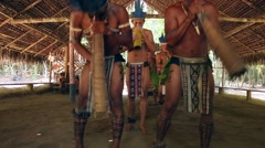 Native Brazilians doing their ritual at an indigenous tribe in the Amazon Stock Footage
