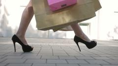 Confident lady at heels with shopping bags walking after shopping time - stock footage